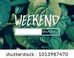 weekend loading word on green... | Shutterstock . vector #1013987470
