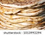 pita. pile of roasted pita ... | Shutterstock . vector #1013992294