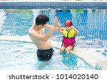 asian father and adorable... | Shutterstock . vector #1014020140