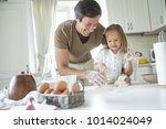 the family cooks in the kitchen | Shutterstock . vector #1014024049