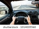 driving car pov on a highway  ... | Shutterstock . vector #1014035560