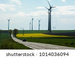 landscape with wind turbines in ... | Shutterstock . vector #1014036094