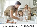 the family cooks in the kitchen  | Shutterstock . vector #1014036589