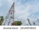 Small photo of Telephone tower Located among the electric high voltage power poles.It needs a lot of height to transmit signal.mobile phone signaling transmissions require a lot of electric power.