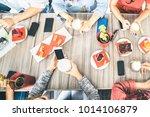 top view of friends drinking...   Shutterstock . vector #1014106879
