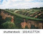 green grass covers hills under...   Shutterstock . vector #1014117724