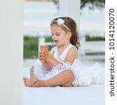 little girl eating ice cream...   Shutterstock . vector #1014120070