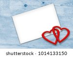two hearts on wooden background.... | Shutterstock . vector #1014133150