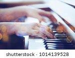 close up of a man  hands plays... | Shutterstock . vector #1014139528