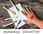 painted mini heart on back hand ... | Shutterstock . vector #1014147769