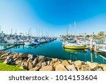 oceanside harbor under a blue... | Shutterstock . vector #1014153604