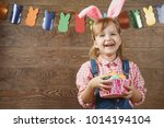 a girl with rabbit ears is... | Shutterstock . vector #1014194104