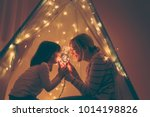 mother and daughter sitting in... | Shutterstock . vector #1014198826