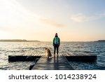 Woman With Dog Enjoy Sunrise...