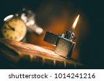 burning brushed chrome lighter...   Shutterstock . vector #1014241216