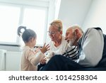 grandparents spending time with ... | Shutterstock . vector #1014258304