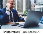 confident businessman in suit... | Shutterstock . vector #1014266014