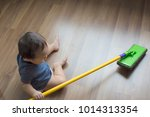 a baby boy is helping on... | Shutterstock . vector #1014313354