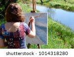 rear view of artist paints a...   Shutterstock . vector #1014318280
