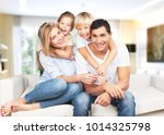 happy family sitting on floor... | Shutterstock . vector #1014325798