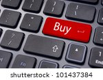 a buy message on keyboard key, for online shopping or stock market investment concepts. - stock photo