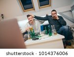friends watching sport on tv at ... | Shutterstock . vector #1014376006