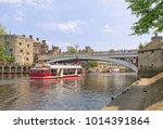 river ouse flowing under lendal ... | Shutterstock . vector #1014391864