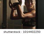 muscular woman holding... | Shutterstock . vector #1014402250
