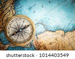 old vintage retro compass on... | Shutterstock . vector #1014403549