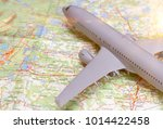 plane on the map. traveling... | Shutterstock . vector #1014422458