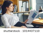 pregnant business woman working ... | Shutterstock . vector #1014437110