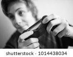 boy teenager with joystick... | Shutterstock . vector #1014438034