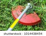 gasoline lawn trimmer mows... | Shutterstock . vector #1014438454