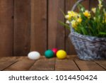 easter eggs and tulips on... | Shutterstock . vector #1014450424