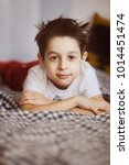 funny boy is lying on the sofa... | Shutterstock . vector #1014451474