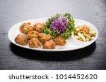 thai style fish cakes serve... | Shutterstock . vector #1014452620