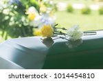 A Closeup Of Flowers Atop A...