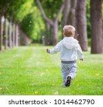 little boy running in park ...   Shutterstock . vector #1014462790