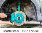 hand and man remove nut lock... | Shutterstock . vector #1014470050