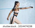 strong woman using resistance... | Shutterstock . vector #1014474238