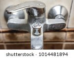 dirty old faucet in the bathroom   Shutterstock . vector #1014481894