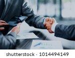 business people shaking hands. | Shutterstock . vector #1014494149