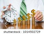 businessman hand holding golden ... | Shutterstock . vector #1014502729