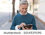 senior mature man walking using ...   Shutterstock . vector #1014519190