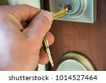 hand unlocking pad lock of... | Shutterstock . vector #1014527464