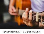 closeup hand musician playing... | Shutterstock . vector #1014540154