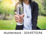 sport man drinking water bottle. | Shutterstock . vector #1014573196