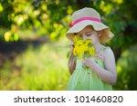 adorable kid smelling flowers ... | Shutterstock . vector #101460820