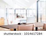 laptop computer on wooden table ... | Shutterstock . vector #1014617284