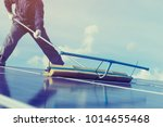 labor working on cleaning solar ... | Shutterstock . vector #1014655468